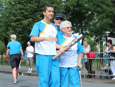 Flora Pagan recieves Queen's Baton in Govan