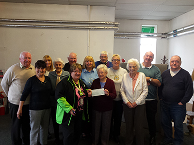 Govan Reminiscence Group receive cheque from Wilma Mchardy of Asda Govan