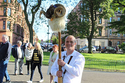 Govan Reminiscence Group member Colin Quigley carries Sheep's Heid at Govan Fair